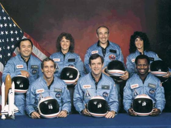 The crew of STS-51-L: (front row) Michael J. Smith, Dick Scobee, Ronald McNair; (back row) Ellison Onizuka, Christa McAuliffe, Gregory Jarvis, Judith Resnik.