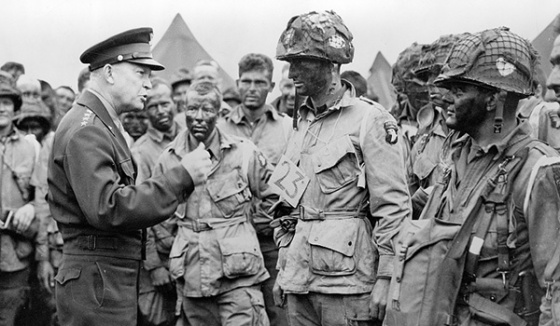 General Eisenhower speaks with paratroopers from the 101st Airborne Division prior to the invasion. (Photo via Library of Congress)
