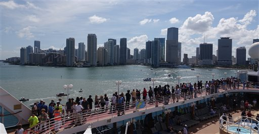 Passengers on board the Adonia watch as the ship leaves port in Miami, Sunday, May 1, 2016, en route to Cuba. After a half-century of waiting, passengers finally set sail on Sunday from Miami on an historic cruise to Cuba. Carnival's Cuba cruises, operating under its Fathom band, will visit the ports of Havana, Cienfuegos and Santiago de Cuba. (Joe Cavaretta/South Florida Sun-Sentinel via AP)  MAGS OUT; MANDATORY CREDIT
